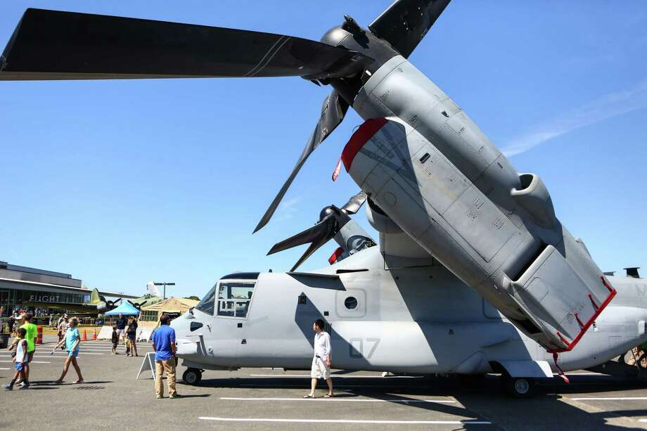 A US Marine MV-22 Osprey is shown at the Museum of Flight as U.S. Navy Blue Angels perform aerial maneuvers and formations over Seattle and Lake Washington as part of a practice session on Thursday July 31, 2014. The Museum is hosting Marine Week where weapons and machinery used by Marines is on display. Photo: JOSHUA TRUJILLO, SEATTLEPI.COM / SEATTLEPI.COM