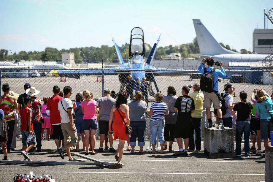 Spectators gather as U.S. Navy Blue Angels planes return to Boeing Field after a practice session on Thursday July 31, 2014. The Blue Angels will perform at the annual Seafair summer celebration. Photo: JOSHUA TRUJILLO, SEATTLEPI.COM / SEATTLEPI.COM
