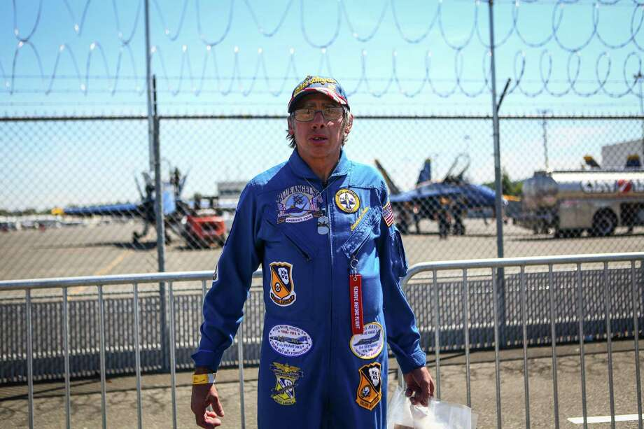 Scott Woods of Tacoma shows his appreciation for the Blue Angels at the Museum of Flight after a practice session on Thursday July 31, 2014. Photo: JOSHUA TRUJILLO, SEATTLEPI.COM / SEATTLEPI.COM