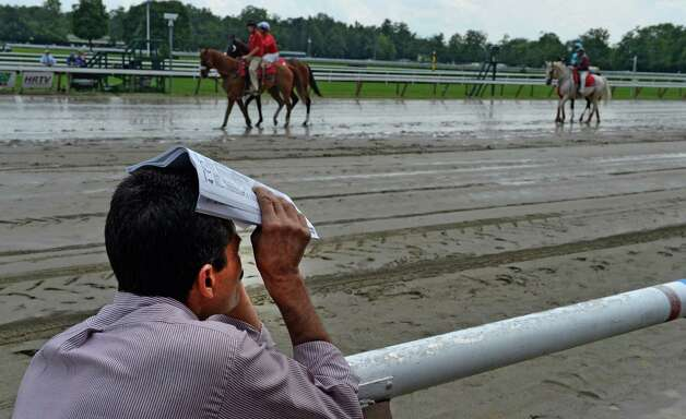 Trainer Rudy Rodriguez checks out the competition before the 7th race Thursday afternoon July 31, 2014 at the Saratoga Race Course in Saratoga Springs, New York.    (Skip Dickstein / Times Union) Photo: SKIP DICKSTEIN