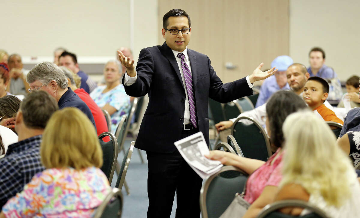 Councilman Diego Bernal speaks during a Barbara Drive drainage project meeting held at Blessed Sacrament School Monday July 28, 2014.