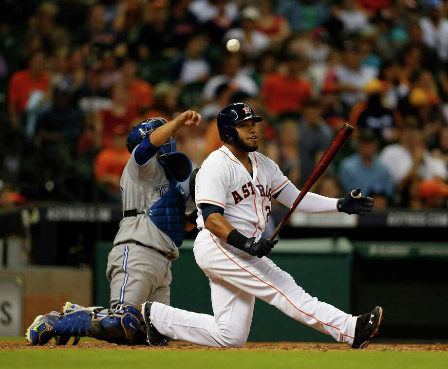A sixth-inning strikeout brings Astros first baseman Jon Singleton, right, to his knees Thursday night. The rookie struck out three times Thursday, but he did win one battle, slugging a home run in the second inning. Photo: Karen Warren, Staff / © 2014 Houston Chronicle
