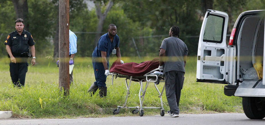 The body of a man identified as Donn Eastman, who was shot by a San Antonio officer, is removed from a field in the 2700 block of Danbury Road on the Northeast Side. Photo: John Davenport / San Antonio Express-News / ©San Antonio Express-News/John Davenport