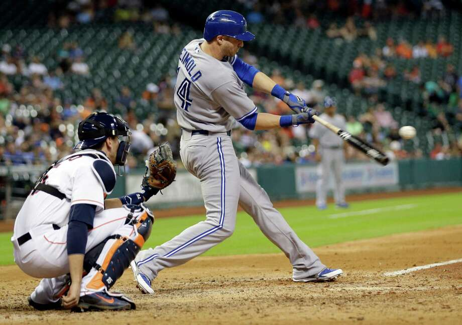 Toronto Blue Jays' Nolan Reimold (14) hits a home run as Houston Astros catcher Jason Castro, left, reaches for the pitch during the ninth inning of a baseball game Thursday, July 31, 2014, in Houston. (AP Photo/David J. Phillip) ORG XMIT: TXDP125 Photo: David J. Phillip / AP