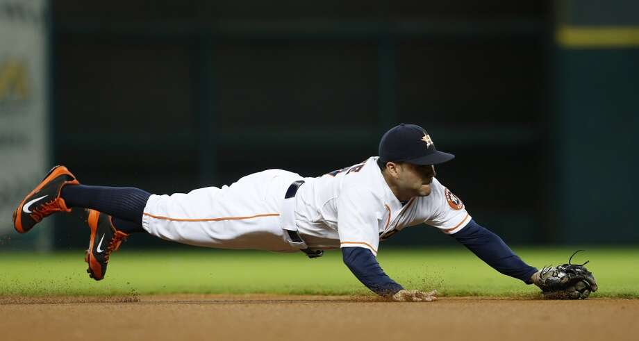 July 31: Blue Jays 6, Astros 5  Jose Altuve dives for a single in the first inning. Photo: Karen Warren, Houston Chronicle