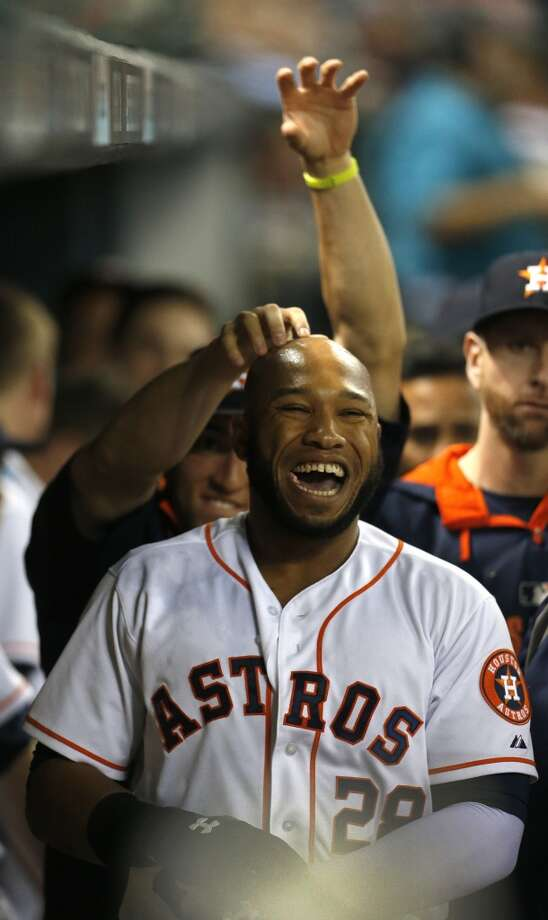 Jon Singleton laughs as he and teammates celebrate his home run in the second inning. Photo: Karen Warren, Houston Chronicle