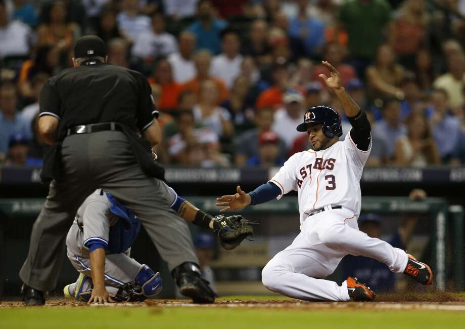 Gregorio Petit beats the play at the plate on a an RBI single in the third inning. Photo: Karen Warren, Houston Chronicle