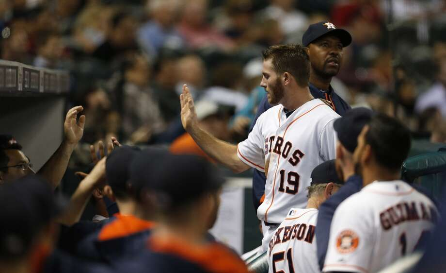 Robbie Grossman celebrates with teammates in the third inning. Photo: Karen Warren, Houston Chronicle