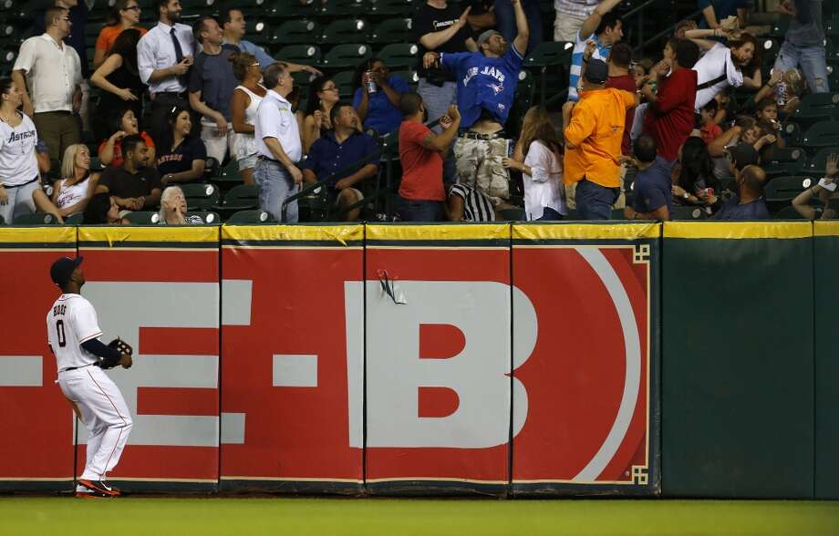 L.J. Hoes watches a home run ball go into the stands to tie the game in the sixth inning. Photo: Karen Warren, Houston Chronicle