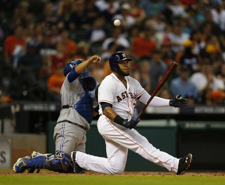 Jon Singleton falls to the ground after swinging through a strike in the sixth inning. Photo: Karen Warren, Houston Chronicle
