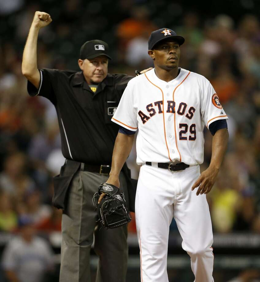 Home plate umpire Paul Emmel calls  Toronto Blue Jays second baseman Steve Tolleson (not pictured) out for interference as Astros relief pitcher Tony Sipp (29) looks on in the seventh inning. Photo: Karen Warren, Houston Chronicle