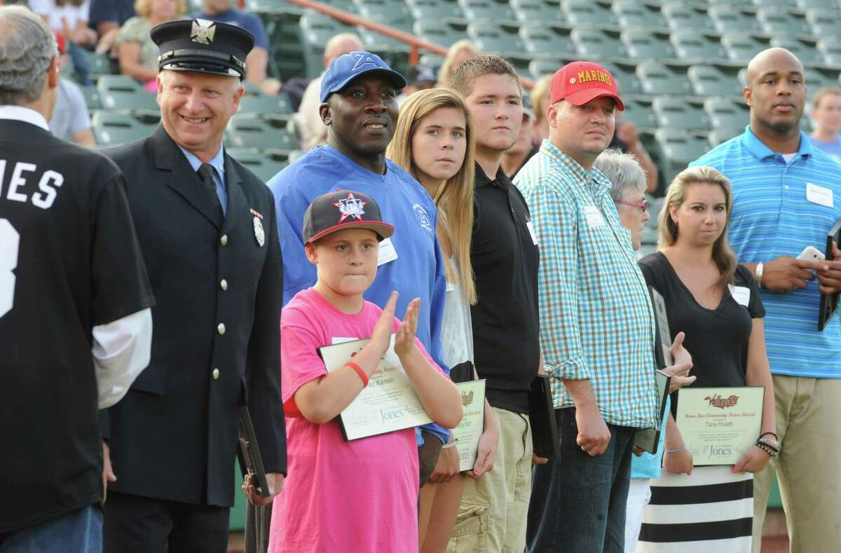 ValleyCats Home Run Community Hero Award recipients watch the first pitches being thrown at a Tri-City ValleyCats baseball game against the Mahoning Valley Scrappers at Joe Bruno Stadium on Thursday, July 31, 2014 in Troy, N.Y. (Lori Van Buren / Times Union)