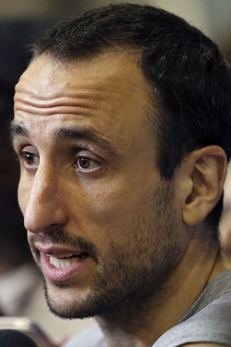 Argentina's Manu Ginobili suffered a stress fracture in his right leg during the Spurs' run to the NBA title. / © 2014 San Antonio Express-News
