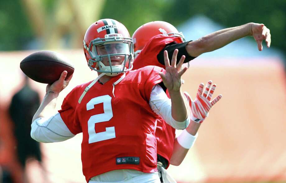 "Browns rookie quarterback Johnny Manziel, the backup to Brian Hoyer, said he's had ""ups and downs"" while learning the team's offense. Photo: Aaron Josefczyk / Associated Press / FR171101 AP"