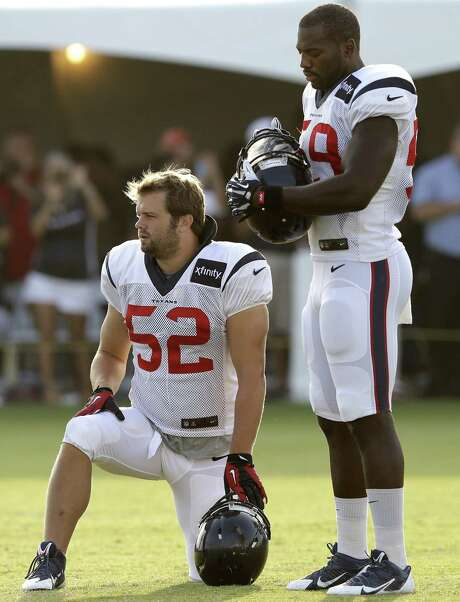 Whitney Mercilus (right) had seven sacks while starting all 16 games during last season's disastrous 2-14 campaign. Photo: Pat Sullivan / Associated Press / AP