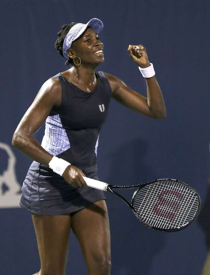 Venus Williams exults after beating Victoria Azarenka 6-4, 7-6 (1) in their quarterfinal match in the Bank of the West Classic. Photo: Jeff Chiu, Associated Press