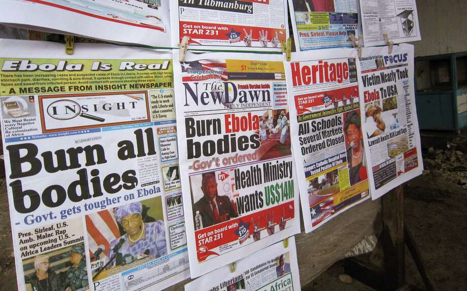 "Newspapers' front pages focus on the Ebola outbreak with headlines such as ""Burn all bodies"" in the city of Monrovia, Liberia, as West African deaths from the virus surpassed 700 this week. Photo: Jonathan Paye-Layleh / Associated Press / AP"