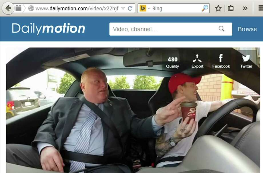 "Toronto Mayor Rob Ford takes his order of ""five espressos in one cup"" from DJ deadmau5. Photo: Courtesy Photo / screen grab"