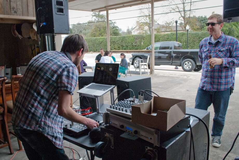 Local funk/soul/reggae DJ collective Son of Hot Damn plays a Friday afternoon lunch show at the Banh Mon Renegade Street Food truck. Photo: Cat5