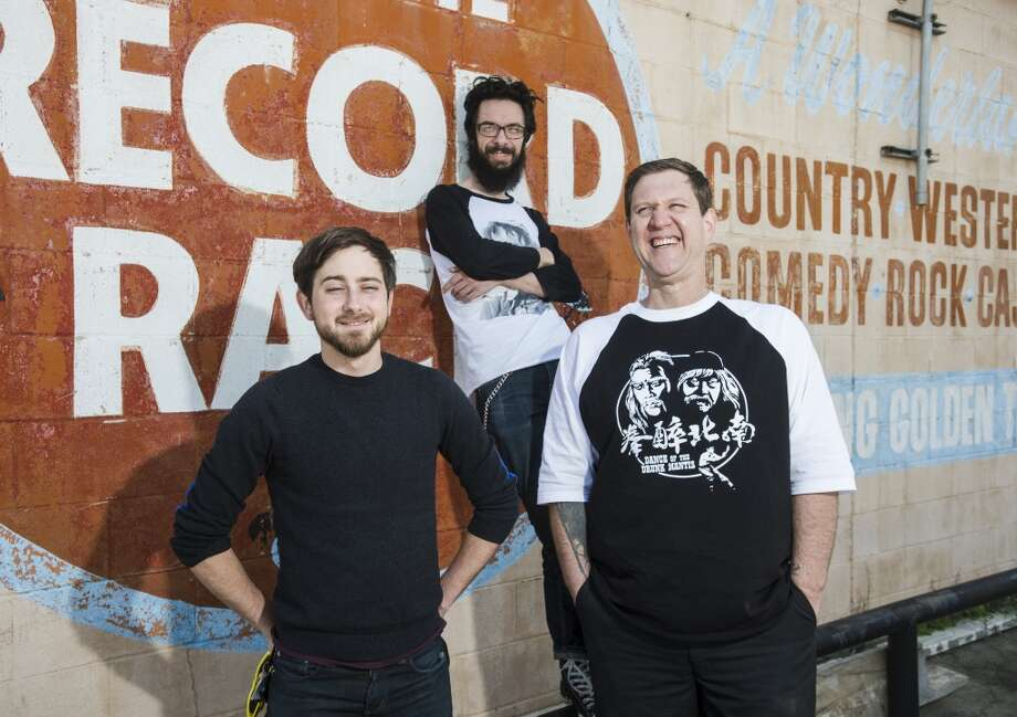 "Disc jockey group Son of Hot Damn -- Zach ""Gazebos"" Bowman, Clayton ""Flash Hercules"" Coburn, and Graham ""Fat George Clooney"" King, left to right -- pose for pictures outside the closed Record Rack store Tuesday afternoon.  Photo taken Tuesday, 4/8/14 Jake Daniels/@JakeD_in_SETX"
