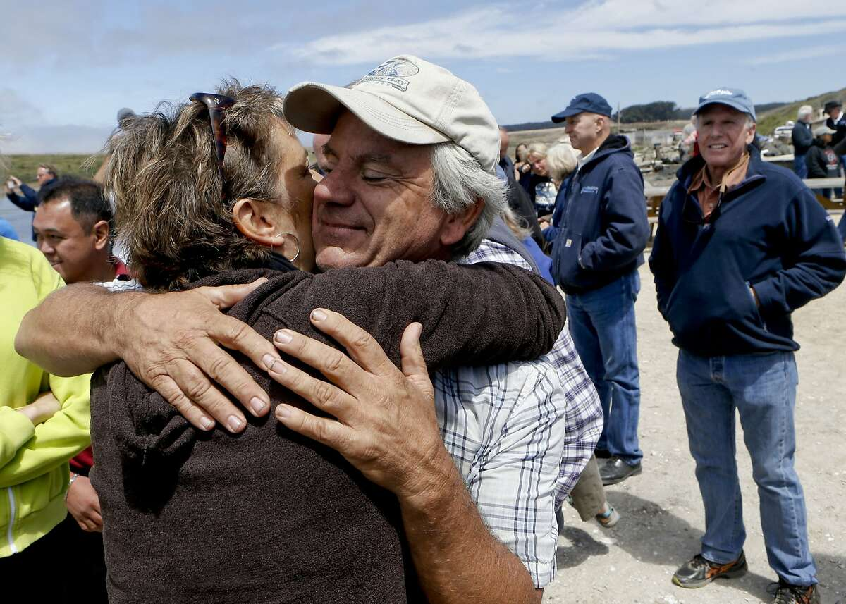 Drakes Bay Oyster Company owner Kevin Lunny is greeted by friends and supporters on Thursday July 31, 2014, in Inverness, Calif. The final day that the public can purchase oysters from the Drake's Bay Oyster Company as their lease expires with the National Park Service and the area reverts to a marine sanctuary.