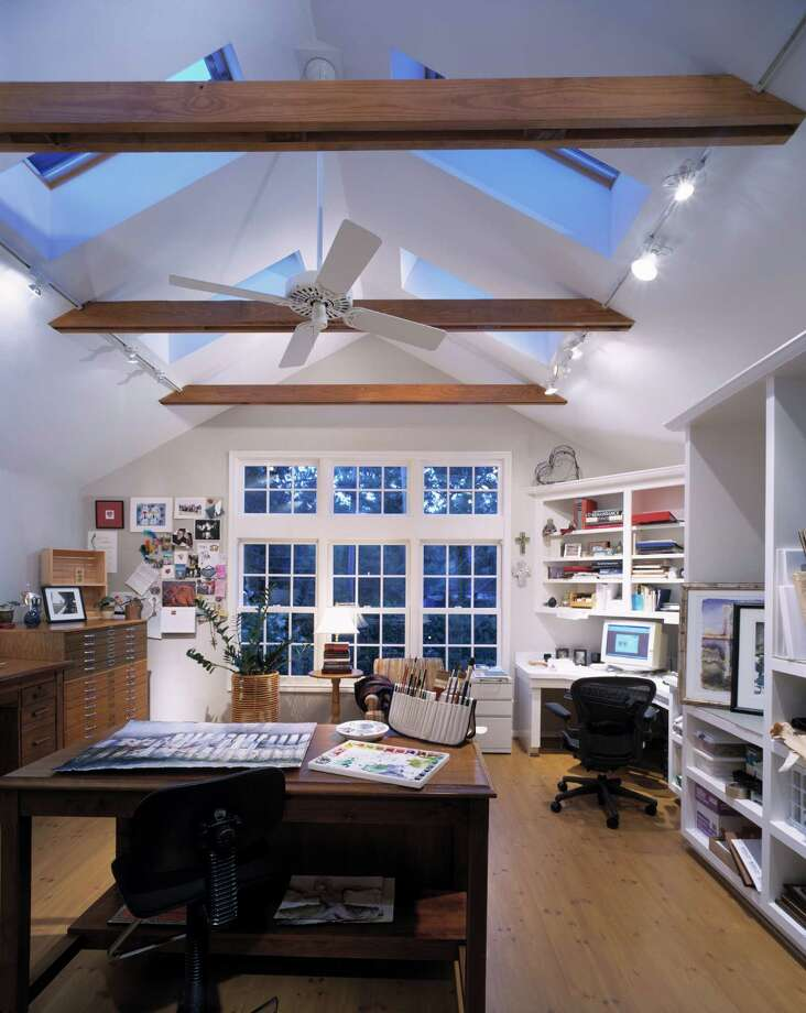 This home office, created by Craftsmanship by John, provides multiple work areas.