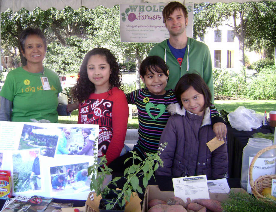 Urban Harvest curriculum coordinator Irene Nava assists young garden entrepreneurs at the Whole Kids Market, a project of Whole Foods Whole Kids Foundation. The foundation also offers grants for school gardens. Photo: Picasa