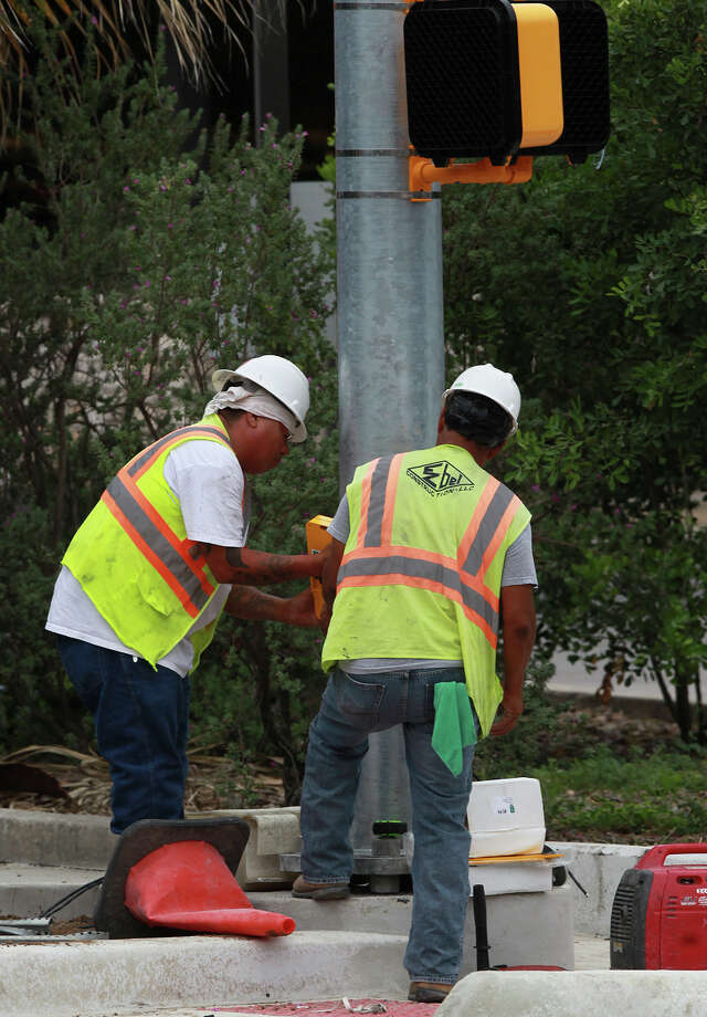Work continues Friday August 1, 2014 near intersection of Hildebrand and Broadway after almost all barriers have been removed and lanes opened in the area after construction in the area began in early 2013. Lanes were opened and lights were turned on Thursday night. Alternating lanes will be closed occasionally for pavement work. Photo: JOHN DAVENPORT, San Antonio Express-News / ©San Antonio Express-News/John Davenport