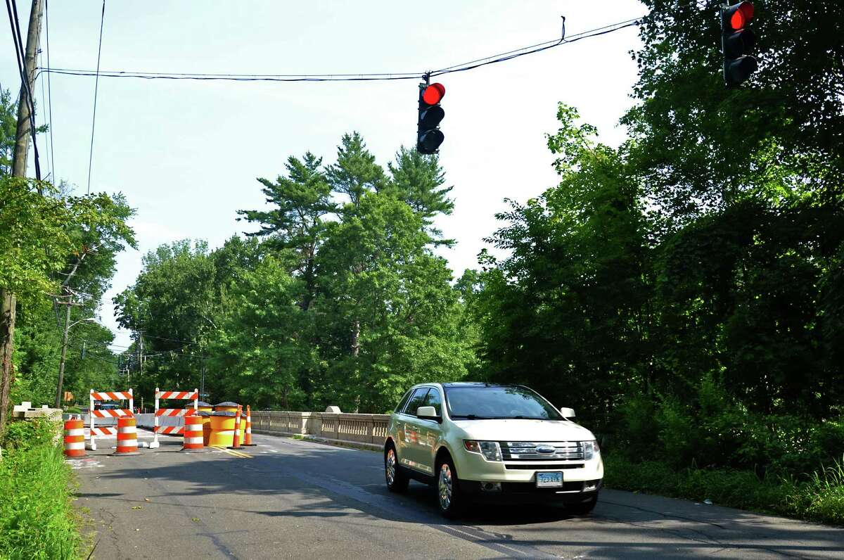 A temporary one-way signal is seen on the Ponus Ridge Road overpass to the Merritt Parkway in New Canaan, Conn., on Friday, Aug. 1, 2014. The signal will continue 24 hours a day until the end of the summer, according to the state Department of Transportation.