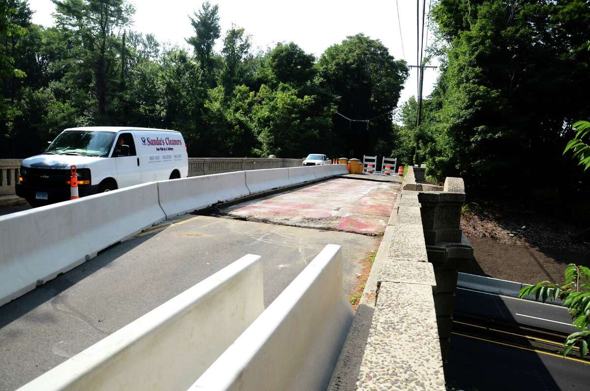 A temporary concrete barrier is seen on the Ponus Ridge Road overpass at the Merritt Parkway in New Canaan, Conn., on Friday, Aug. 1, 2014. The lane closure will allow the replacement of the roadway surface as well as the rehabilitation of the bridge deck.