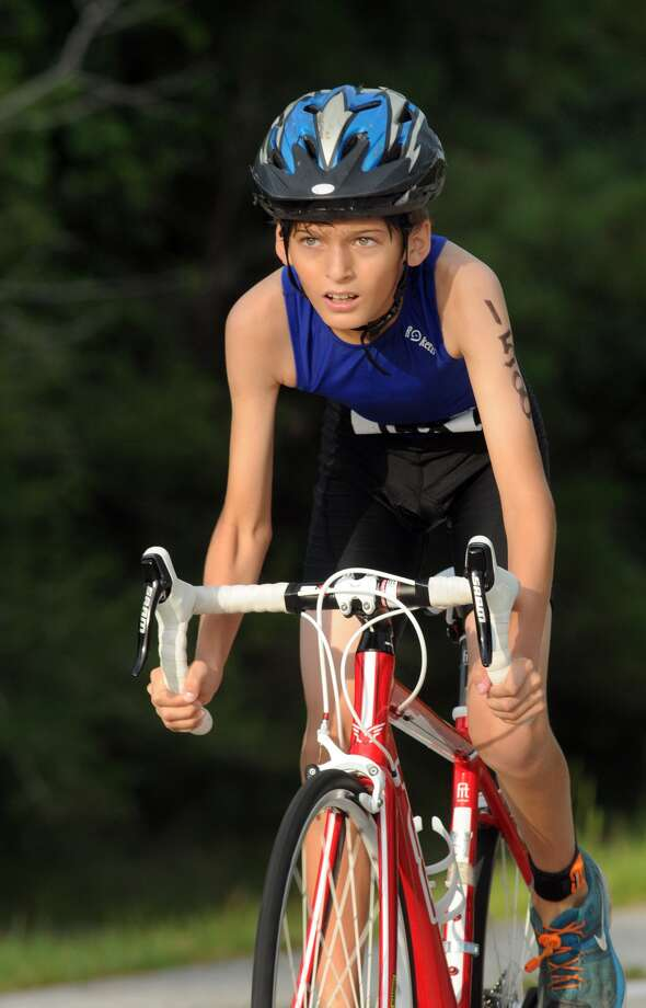 Patricio Fernandez Del Castil, 11, of The Woodlands, competes in the cycling portion of the Greater Houston Kiwanis Kids Triathlon at the South Montgomery County YMCA on July 26. Photo: Jerry Baker, For The Chronicle
