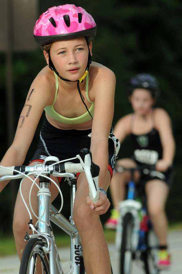 Emily Potter, 12, a 6th grader at The Village School in Memorial (77079), competes in the cycling portion of the Greater Houston Kiwanis Kids Triathlon at the South Montgomery County YMCA on July 26. Photo: Jerry Baker, For The Chronicle