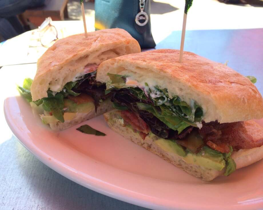 The Buttery: Eating a bacon, lettuce, tomato and avocado sandwich, slathered with mayo is enhanced by sitting outside, under the shade of an umbrella.