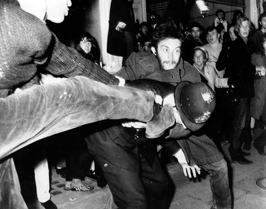 A London policeman is kicked in the head during a protest demonstration against the war in Vietnam. Violence broke out near the American Embassy in Grosvenor Square, 1968. Photo: Bob Aylott, Getty Images / Hulton Archive