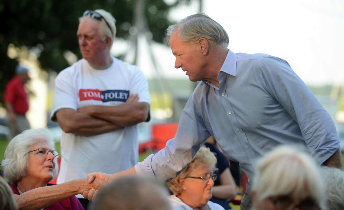Republican gubernatorial candidate Tom Foley talks with Patti Grabiec, of Trumbull, while on the campaign trail in Stratford, Conn. Thursday, July 31, 2014 at Festival Stratford on the grounds of the American Shakespeare Theater.