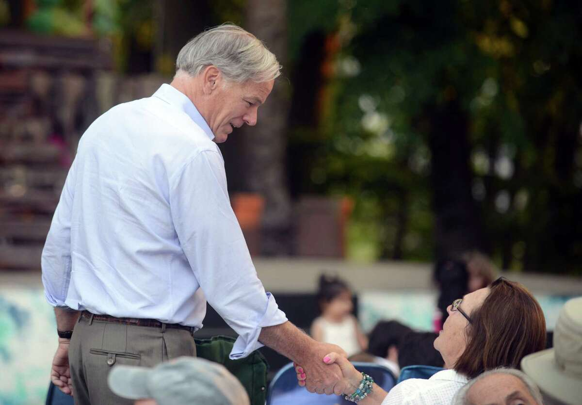 Republican gubernatorial candidate Tom Foley talks with Halina Slawsky, of Orange, while on the campaign trail in Stratford, Conn. Thursday, July 31, 2014 at Festival Stratford on the grounds of the American Shakespeare Theater.