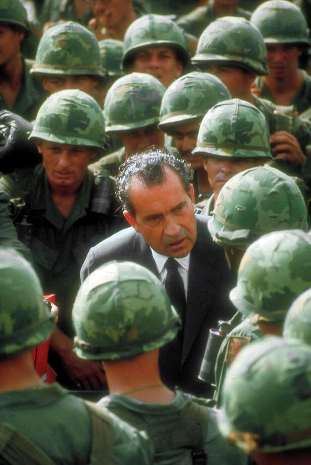Pres. Dick Nixon speaking with US soldiers during surprise visit to war zone in South Vietnam, 1969. Photo: Arthur Schatz, The LIFE Picture Collection/Gett / Time Life Pictures