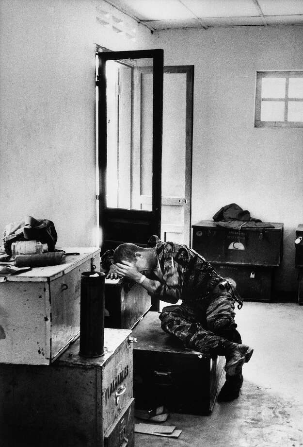 Lance corporal James C. Farley breaking down in tears over the death of fellow soldiers after a confrontation with Viet Cong, Vietnam, March 31, 1965. Photo: Larry Burrows, The LIFE Picture Collection/Gett / Time Life Pictures