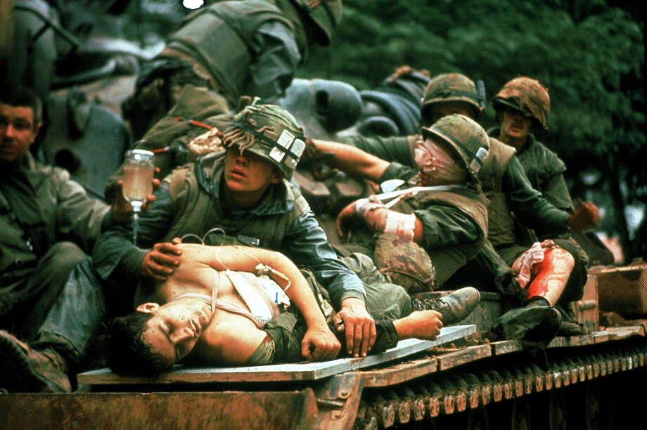 Wounded Marines ride on top of converted tank used as make-shift ambulance during the battle to recapture the city of Hue during the Tet Offensive in the Vietnam War, Hue, Vietnam, early 1968. Photo: John Olson, The LIFE Images Collection/Getty / Time Life Pictures