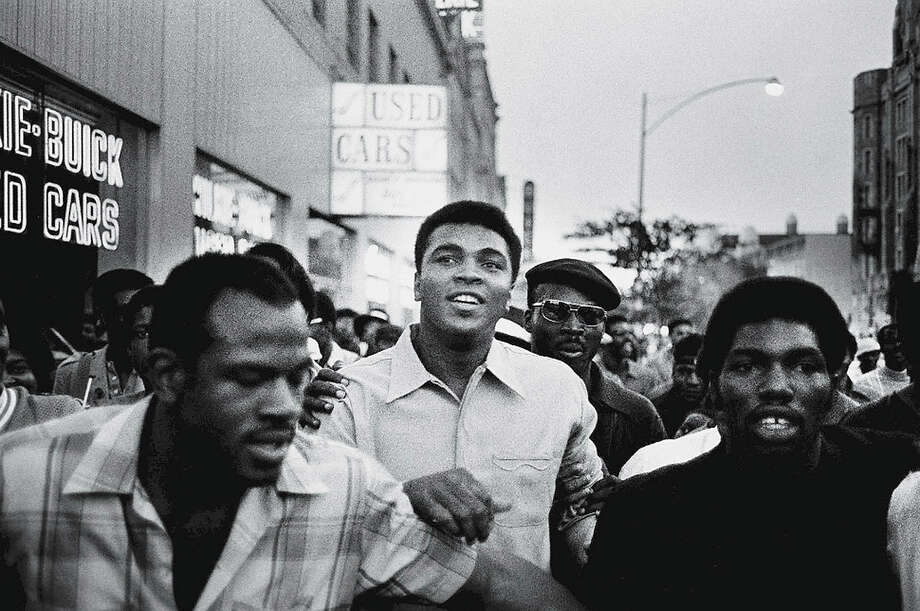 Heavyweight boxing champion Muhammad Ali walks through the streets with members of the Black Panther Party, New York, September 1970. Ali was sentenced to five years in prison and his championship title revoked after he was convicted of draft evasion upon his refusal to serve with the American army in Vietnam upon grounds of conscientious objection. The decision was overtuned in 1971. Photo: David Fenton, Getty Images / 2006 Getty Images