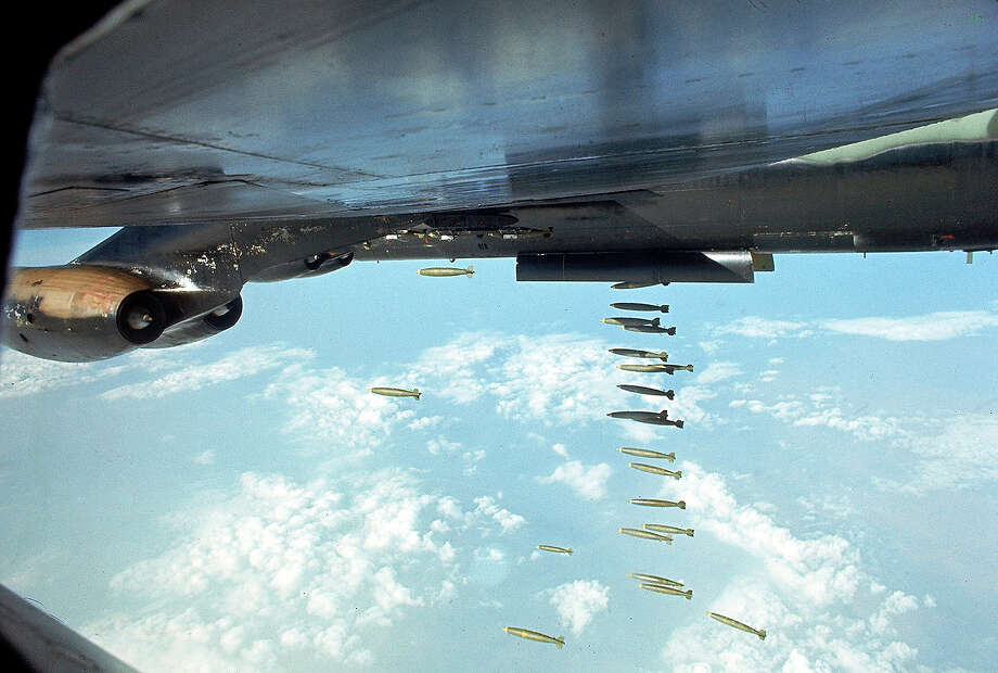 An American B-52 dropping payload of bombs onto Viet Cong positions during the Vietnam War, 1968. Photo: Co Rentmeester, The LIFE Picture Collection/Gett / Time & Life Pictures/Getty Images