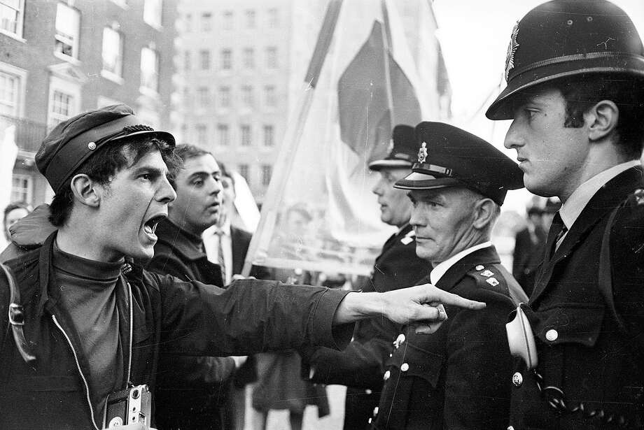The police submit to a vehement haranguing from a protestor at an anti-Vietnam War demonstration in Grosvenor Square, London, 1966. Photo: Clive Limpkin, Getty Images / Hulton Archive