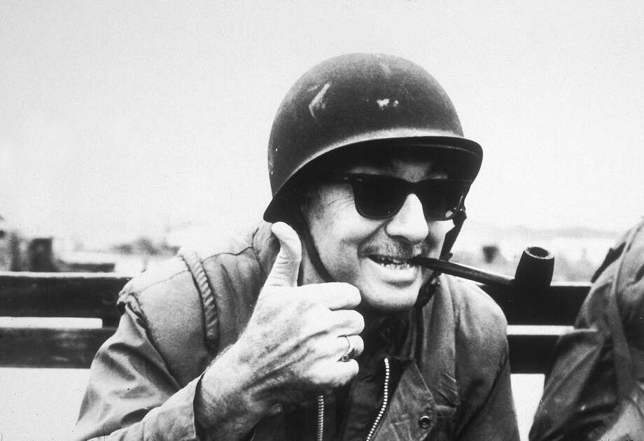 American broadcast journalist Walter Cronkite gives a thumbs up with his pipe clenched between his teeth while reporting for CBS in Vietnam, 1968. Photo: CBS Photo Archive, Getty Images / CBS