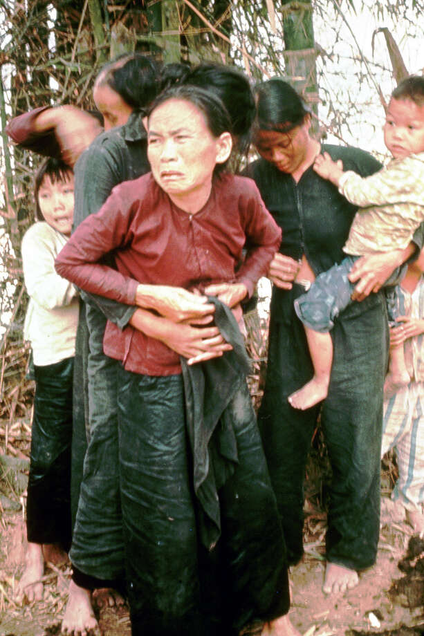 A group of civilian women and children rounded up to be killed by US Army during massacre of village while in pursuit of Vietcong militia, as per order of Lieut. William Calley Jr. (later court-martialed), later known as the Vietnam War's Mylai massacre, 1968. Photo: Ronald S. Haeberle, Time & Life Pictures/Getty Image / Ronald S. Haeberle