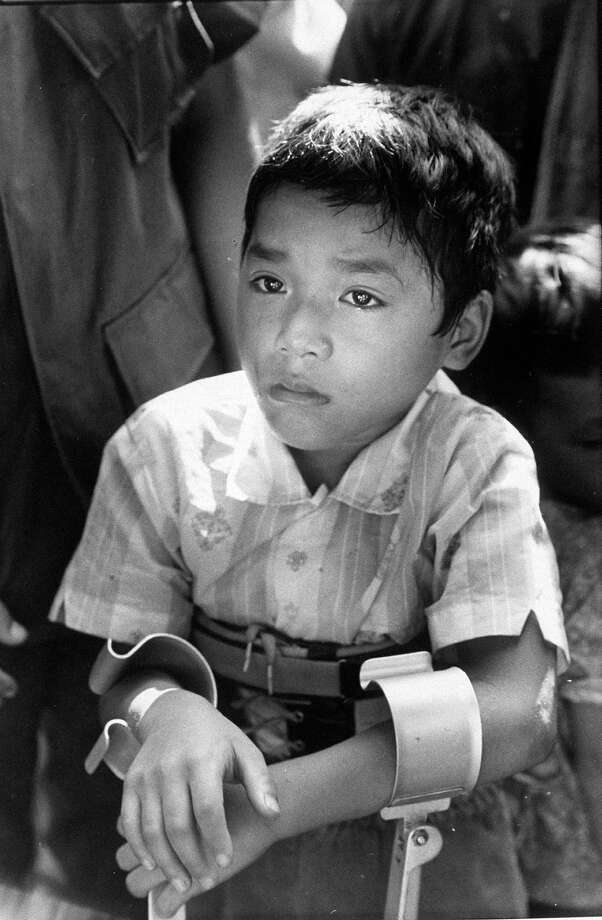 0-year old paraplegic Lau Nguyen, wounded during the Vietnam War returning home after 3 years of medical treatment in the US, 1970. Photo: Larry Burrows, The LIFE Picture Collection/Gett / Time Life Pictures