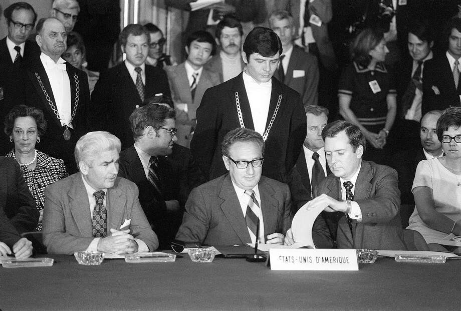 Henry Kissinger, US President Nixon's advisor on national security affairs, signs 13 June 1973 in Paris a cease-fire agreement bringing the Vietnam war to an end. The war ended 31 April 1975 when Saigon surrendered almost without fighting to the Viet-cong communist forces, ending the US's 15-year involvement in Vietnam Photo: -, AFP/Getty Images / AFP