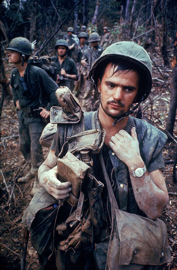 An exhausted US Marine on patrol with his squad near the DMZ during the Vietnam War, 1966. Photo: Larry Burrows, The LIFE Picture Collection/Gett / Time & Life Pictures