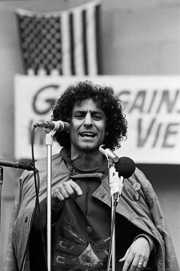American political and social activist Abbie Hoffman speaks from behind a bank of microphones at a rally against the war in Vietnam. Photo: David Fenton, Getty Images / Archive Photos