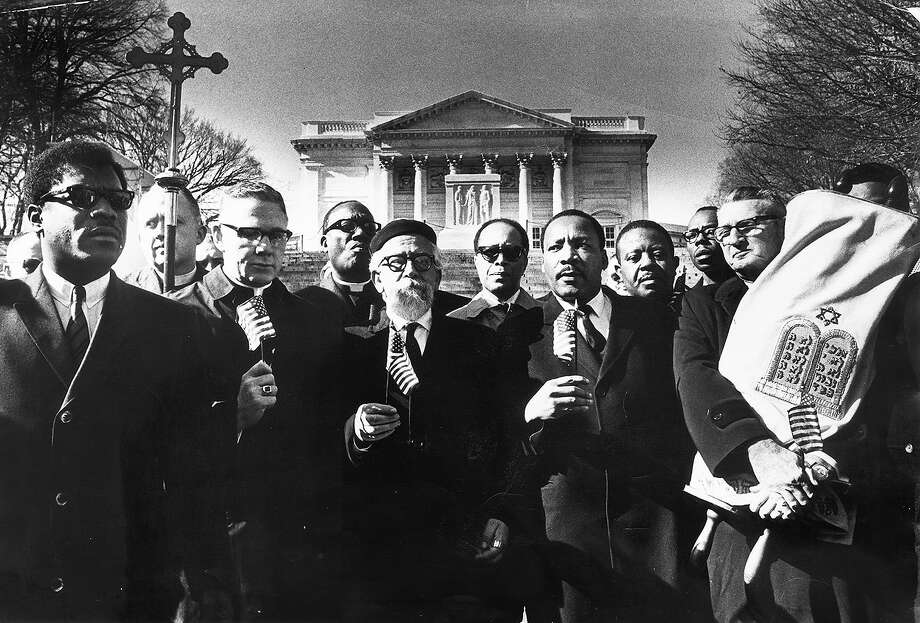Martin Luther King Jr. and other members of the Clergy and Laity Concerned About the War in Vietnam (CALCAV) protest the Vietnam War at Arlington National Cemetery. Photographed February 6, 1968 in Arlington, Virginia. Photo: Charles Del Vecchio, Washington Post / 2011 The Washington Post
