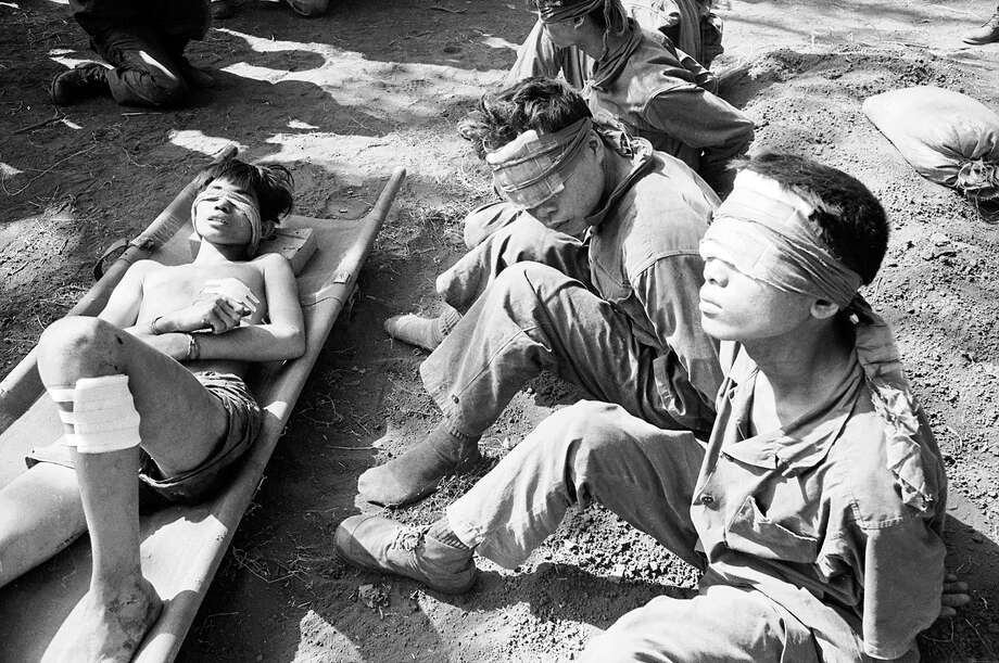 Blindfolded Vietnamese prisoners of war, Vietnam, 1975. Photo: Terry Fincher, Getty Images / 2008 Getty Images